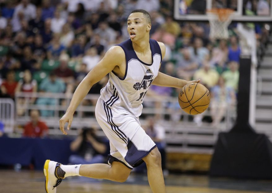 FILE - In this July 6, 2015, file photo, Utah Jazz's Dante Exum brings the ball up during an NBA summer league basketball game against the Boston Celtics in Salt Lake City. Exum has consistently been called the point guard of the future after being drafted No. 5 overall in 2014 by the Jazz but that doesn't mean he'll be the starter next season. Exum started 41 games as a rookie and was supposed to hold onto that role last season but he tore his ACL in the summer and missed the entire year. (AP Photo/Rick Bowmer, File)
