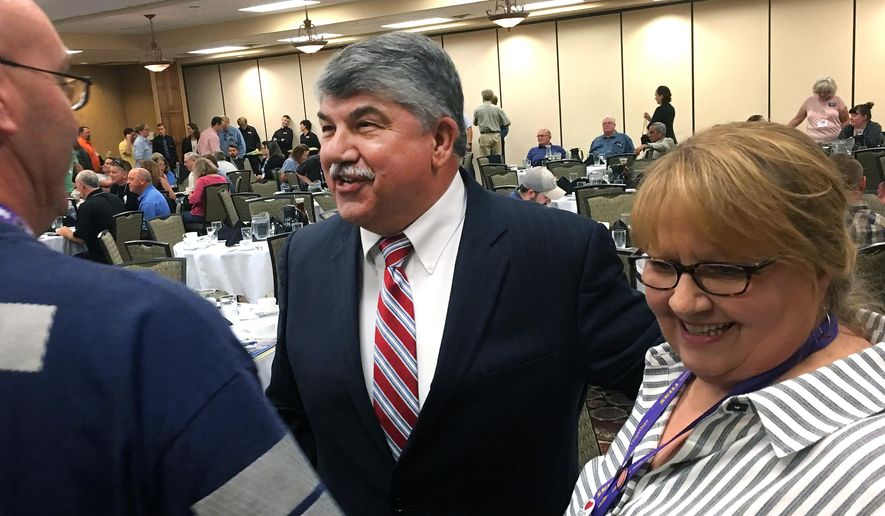 AFL-CIO President Richard Trumka, center, speaks to union supporters in Helena, Mont., on Friday, June 24, 2016. Trumka says the country's largest federation of trade unions will be aggressively backing pro-labor candidates across the country, including Montana Gov. Steve Bullock. (AP Photo/Bobby Caina Calvan)