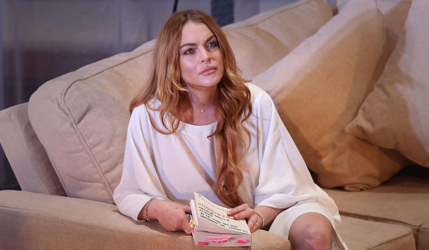 "FILE - In this Tuesday, Sept. 30, 2014, file photo, U.S actress Lindsay Lohan performs a scene from the play, ""Speed the Plow,"" during a photocall at the Playhouse Theatre in central London. Lohan passionately commented on social media Thursday, June 23, 2016, as votes were tallied in the United Kingdoms historic vote to leave the European Union. (Photo by Joel Ryan/Invision/AP, File)"