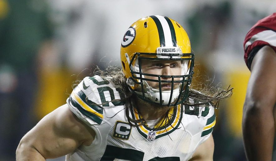 FILE - In this Jan. 16, 2016, file photo, Green Bay Packers inside linebacker Clay Matthews (52) chases a play during an NFL divisional playoff football game against the Arizona Cardinals, in Glendale, Ariz. Matthews, Julius Peppers and James Harrison will be interviewed next month by NFL officials in connection to a media report that linked them to the use of performance-enhancing drugs.  (AP Photo/Rick Scuteri, File)