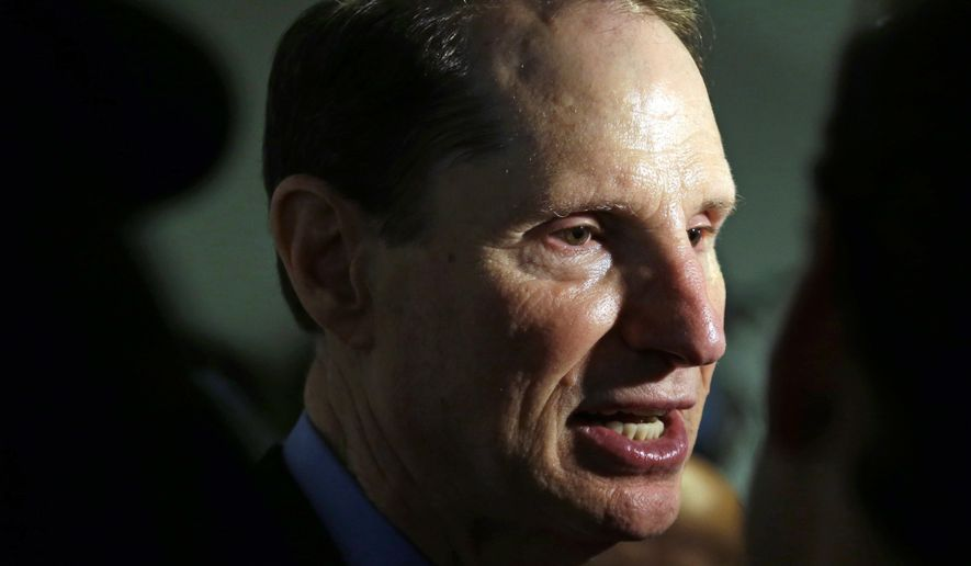 FILE - In this Friday, Sept. 25, 2015, file photo, U.S. Sen. Ron Wyden, D-Ore., speaks after a news conference in Portland, Ore. Wyden is pushing for more answers on why doctors and patient advocates with financial ties to the pharmaceutical industry came to serve on a panel that advises the federal government on pain issues. (AP Photo/Don Ryan, File)