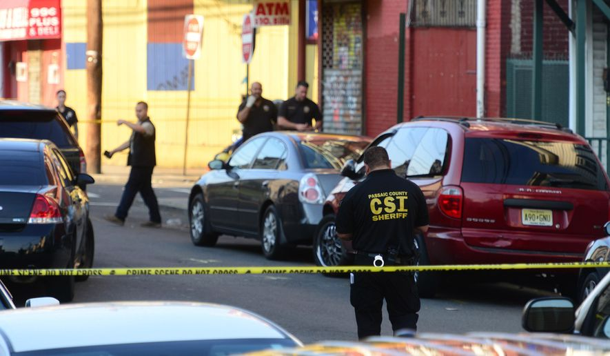 Passaic County Sheriff Department and Prosecutors Office investigate the scene of a police involved shooting, Friday, June 24, 2016 in Paterson, N.J.  Authorities say the officers were walking toward a man when he began firing at them and they returned fire. The officers were not injured. But Police Director Jerry Speziale says they were treated for trauma. The name of the man has not been released.  (Tariq Zehawi/The Record of Bergen County via AP) ONLINE OUT; MAGS OUT; TV OUT; INTERNET OUT;  NO ARCHIVING; MANDATORY CREDIT