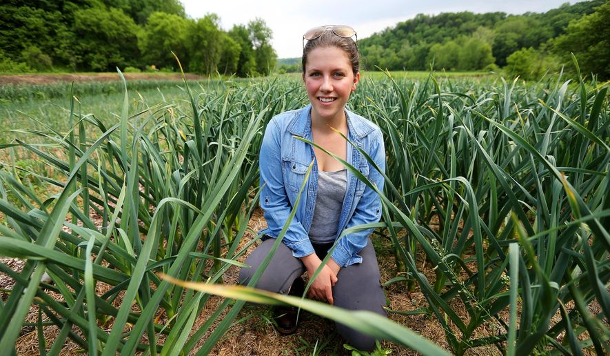 Allison Mitchell is photographed on May 31, 2016 in Dubuque, Iowa.  Mitchell a University of Dubuque student is working with a local farm and volunteers to provide inexpensive fresh produce at two stands in Dubuque.  (Dave Kettering/Telegraph Herald via AP) MANDATORY CREDIT