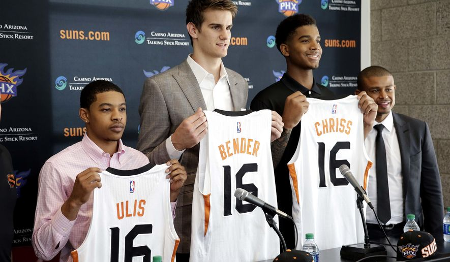 From left to right, Phoenix Suns  second-round draft pick Tyler Ulis and first-round draft picks Dragan Bender and Marquese Chriss are introduced to the media as head coach Earl Watson smiles, Friday, June 24, 2016, in Phoenix. (AP Photo/Matt York)