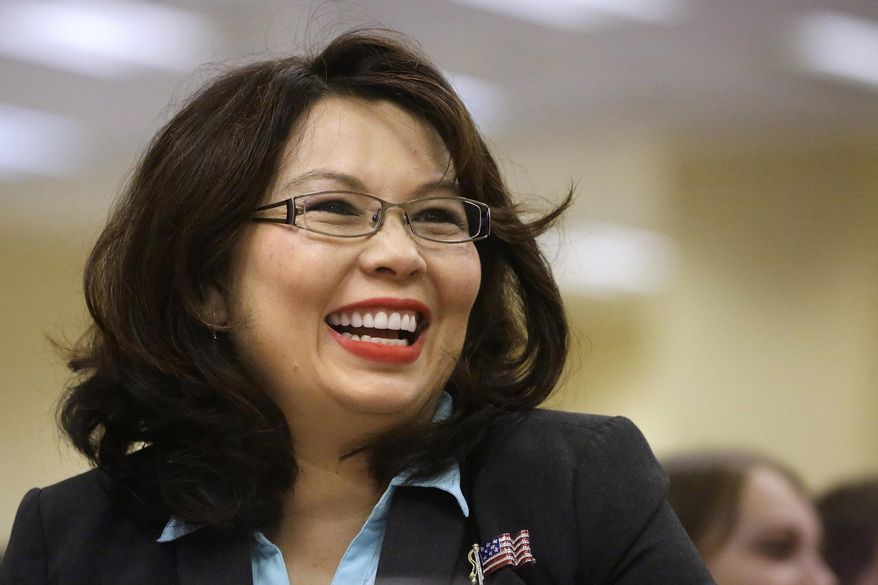 FILE - In this Aug. 13, 2014, file photo, U.S. Rep. Tammy Duckworth, D-Ill., appears in Springfield, Ill. A settlement in the workplace retaliation lawsuit against Duckworth concluded Friday, June, 24, 2016 with an agreement that no law was violated, removing an obstacle in bid to unseat Republican U.S. Sen. Mark Kirk in one of November's most competitive Senate races. (AP Photo/Seth Perlman, File)