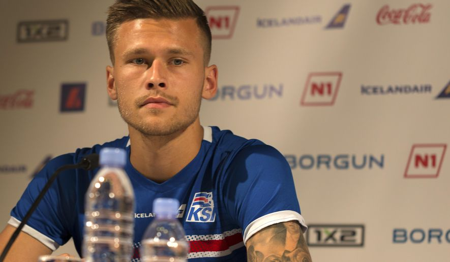 Iceland's midfielder  Arnor Ingvi Traustason listesn during a press conference in Annecy, French Alps, Friday June 24, 2016. (AP Photo/Ciaran Fahey)