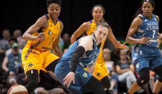 Los Angeles Sparks guard Alana Beard, left, knocks the ball loose while defending Minnesota Lynx guard Lindsay Whalen (13) during the second quarter of a WNBA basketball game Friday, June 24, 2016, in Minneapolis. (Aaron Lavinsky/Star Tribune via AP) MANDATORY CREDIT