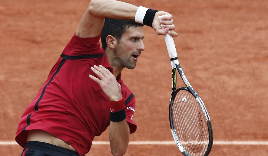 FILE - In this June 5, 2016 file photo, Serbia's Novak Djokovic serves the ball in the final of the French Open tennis tournament against Britain's Andy Murray at the Roland Garros stadium in Paris, France. (AP Photo/Christophe Ena, File)