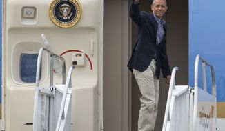 President Barack Obama waves as he boards Air Force One prior to his departure from Seattle-Tacoma International Airport in SeaTac, Wash., Saturday, June 25, 2016.  (AP Photo/John Froschauer)