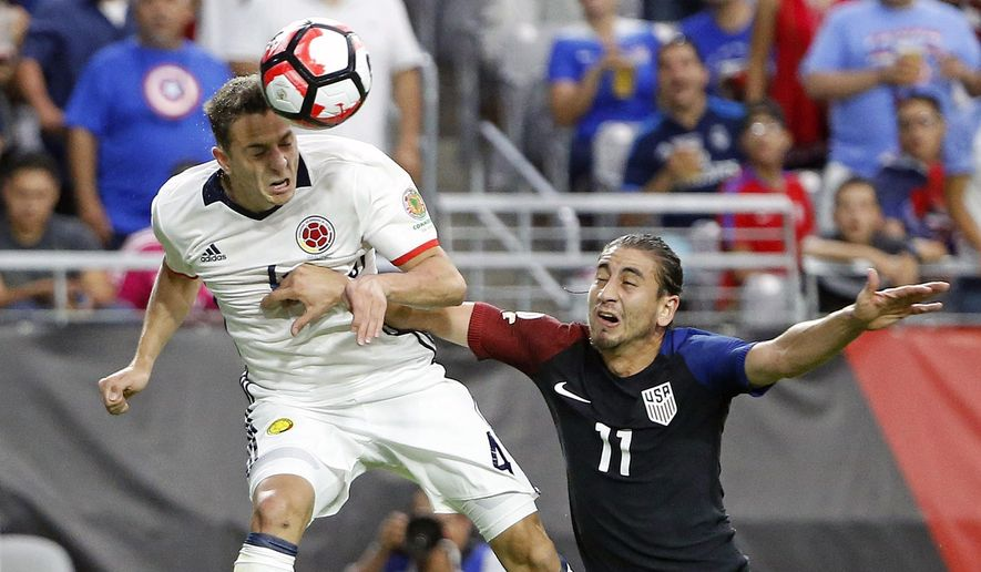 Colombia's Santiago Arias (4) heads the ball to teammate Carlos Bacca as United States' Alejandro Bedoya (11) defends during the first half of the Copa America Centenario third-place soccer match Saturday, June 25, 2016, in Glendale, Ariz. Colombia's Bacca scored on the play. (AP Photo/Ross D. Franklin)