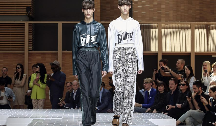 Models wear creations for Kenzo's Men's Spring/Summer 2017 fashion collection presented Saturday, June 25, 2016 in Paris. (AP Photo/Kamil Zihnioglu)