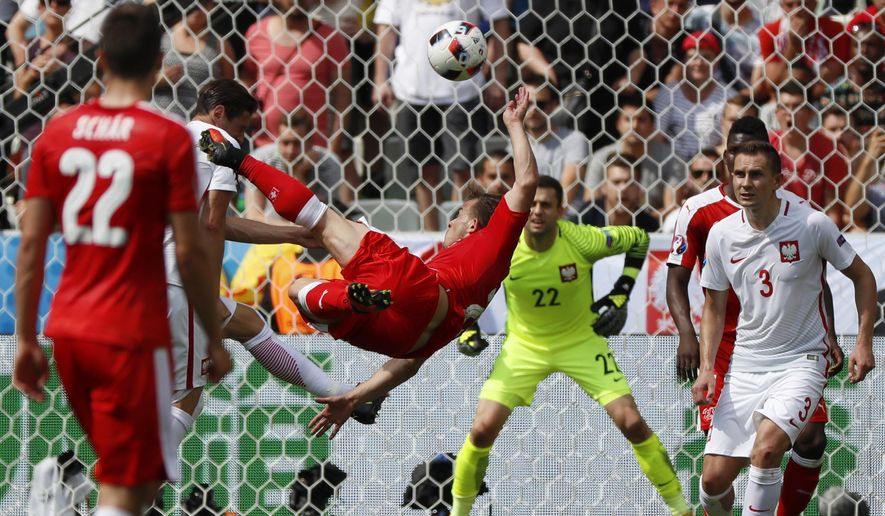 Switzerland's Xherdan Shaqiri scores his side's first goal during the Euro 2016 round of 16 soccer match between Switzerland and Poland, at the Geoffroy Guichard stadium in Saint-Etienne, France, Saturday, June 25, 2016. (AP Photo/Darko Bandic)