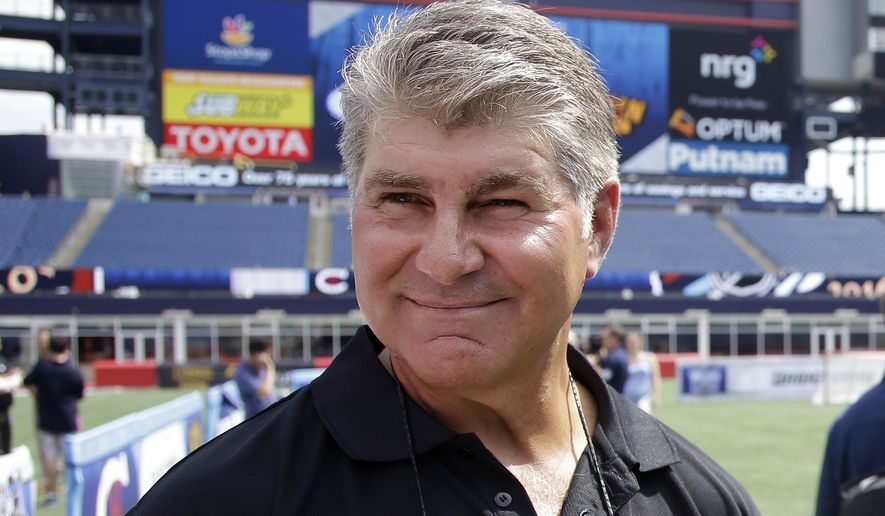 FILE - In this July 29, 2015, file photo, former Boston Bruins star Ray Bourque walks on the field during an event at Gillette Stadium  in Foxborough, Mass. Bourque has been arrested on a drunken driving charge. Andover, Mass., police Lt. Cecilia Blais tells The Boston Globe the 55-year-old was arrested after he was involved in a two-vehicle crash in the city about 11:30 p.m. Friday, June 24, 2016. No injuries were reported. Bourque was charged with operating under the influence, posted bail and was released.  (AP Photo/Stephan Savoia, File)