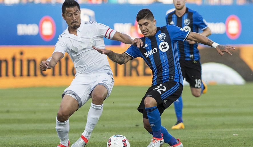 Montreal Impact's Lucas Ontivero, right, challenges Sporting Kansas City's Roger Espinoza during first half MLS soccer action in Montreal, Canada, Saturday, June 25, 2016. (Graham Hughes/The Canadian Press via AP) MANDATORY CREDIT