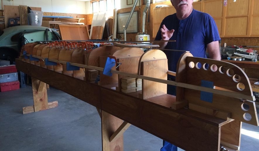 ADVANCE FOR THE WEEKEND OF JUNE 25-26 AND THEREAFTER - Dan Cornell describes what it's like to make a boat by hand. Now retired, Cornell taught boat-making at Butte High School in the 1990s. (Susan Dunlap/Montana Standard via AP)