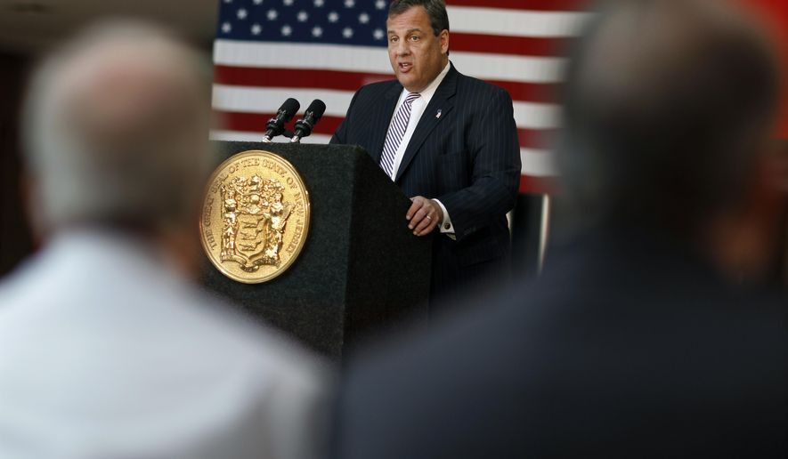 In this Tuesday, June 21, 2016 photograph, New Jersey Gov. Chris Christie addresses a gathering at Hillsborough High School as he proposes redistributing billions of dollars in educational aid from the poorest districts to hundreds of other schools, in Hillsborough Township, N.J. New Jersey's current fiscal year budget ends in about a week, and Republican Gov. Chris Christie is proposing to fill an unexpected $600 million gap in revenue by underspending on programs, including medical assistance to poor familes. (AP Photo/Mel Evans)