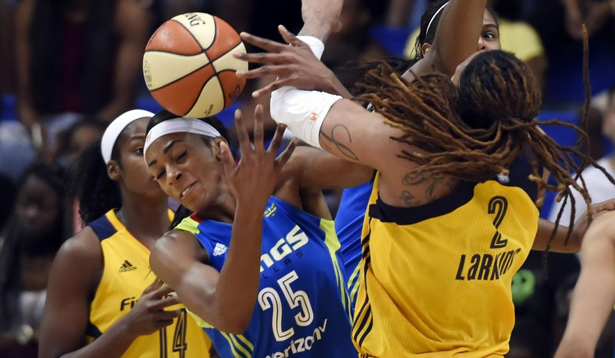 Dallas Wings forward Glory Johnson (25) and Indiana Fever forward Erlana Larkins (2) fight for possession during the first half of their WNBA basketball game at College Park Center in Arlington, Texas, Saturday, June 25, 2016. (Michael Ainsworth/The Dallas Morning News via AP) MANDATORY CREDIT