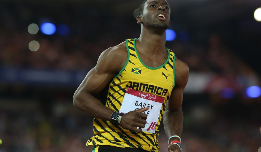 FILE - In this  July 28, 2014 file photo, Kemar Bailey-Cole of Jamaica looks up at a large video screen after winning the men's 100 meter race at Hampden Park stadium during the Commonwealth Games 2014 in Glasgow, Scotland. The Jamaican sprinter says he will participate in next week's Olympic trials despite suffering from the Zika virus. The 24-year-old track star said he has rashes and eye pain but is not afflicted by muscle pain often associated with the virus, the Jamaican Gleaner reported Saturday, June 25, 2016. (AP Photo/ Scott Heppell, File)