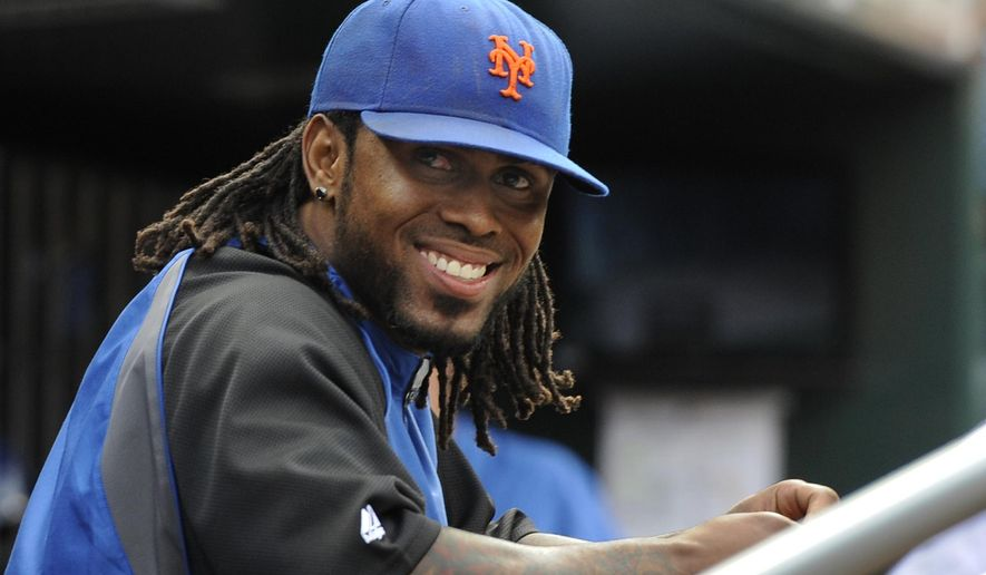 FILE - In this Sept. 28, 2011, file photo, New York Mets' Jose Reyes smiles in the dugout in the ninth inning of a baseball game against the Cincinnati Reds in New York. The Mets have signed Reyes to a minor league contract, Saturday, June 25, 2016.  Reyes, 33, played primarily at shortstop for the Mets from 2003-11, but may be used in a utility role in his reunion with the team. He was cut by Colorado after serving a 59-day suspension for violating Major League Baseball's domestic violence policy.  (AP Photo/Kathy Kmonicek, File)
