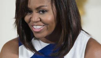 In this June 1, 2016 file photo, First lady Michelle Obama speaks in the East Room of the White House. Michelle Obama and daughters Sasha and Malia are leaving Sunday, June 26 for Africa, where they will promote girls' education in Liberia and Morocco before going to Spain. (AP Photo/Evan Vucci, file) **FILE**
