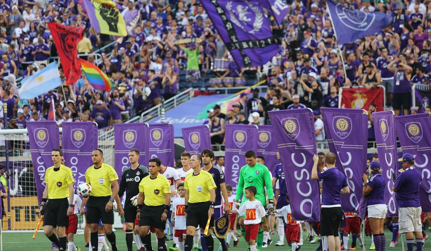 Players of Orlando City and Toronto FC enter the stadium for an MLS soccer game Saturday, June 25, 2016, in Orlando, Fla. (Ricardo Ramirez Buxeda/Orlando Sentinel via AP) MAGAZINES OUT; NO SALES; MANDATORY CREDIT