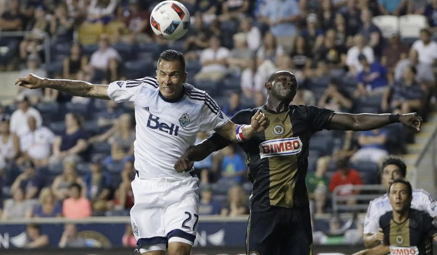 Vancouver Whitecaps's Blas Perez, left, leaps for the ball against Philadelphia Union's Joshua Yaro during the second half of an MLS soccer match, Saturday, June 25, 2016, in Chester, Pa. (AP Photo/Matt Slocum)