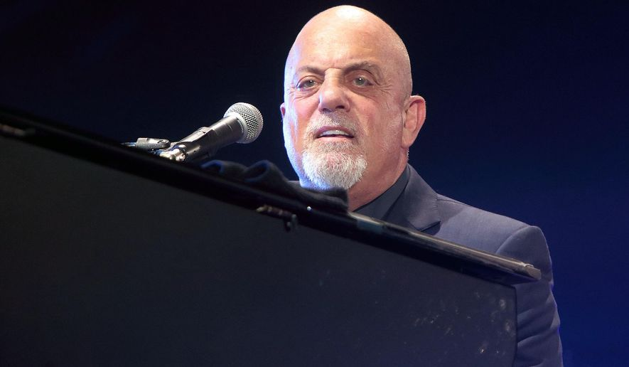 FILE - In this July 25, 2015, file photo, singer-songwriter Billy Joel performs in concert at M&T Bank Stadium in Baltimore.  Fans watching a Billy Joel tribute band were treated to a surprise appearance by the Piano Man himself. Joel was in the audience Friday night, June 24, 2016, with his wife, Alexis Roderick, at a show in Huntington, New York, when he decided to join the band Big Shot for a three-song set. (Photo by Owen Sweeney/Invision/AP, File)