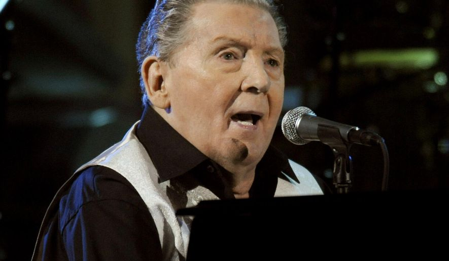 FILE - In this Oct. 30, 2009 file photo, Jerry Lee Lewis performs at the 25th Anniversary Rock & Roll Hall of Fame concert at Madison Square Garden in New York.  An estate sale continues Saturday, June 25, 2016 at Lewis' home in the Mississippi suburbs of Memphis, Tennessee. Lewis' son, Jerry Lee Lewis III, wrote on Facebook that his father and stepmother, Judith, aren't moving. But they want to sell excess furniture and memorabilia that the 81-year-old has accumulated during a career spanning seven decades.(AP Photo/Henny Ray Abrams, file)