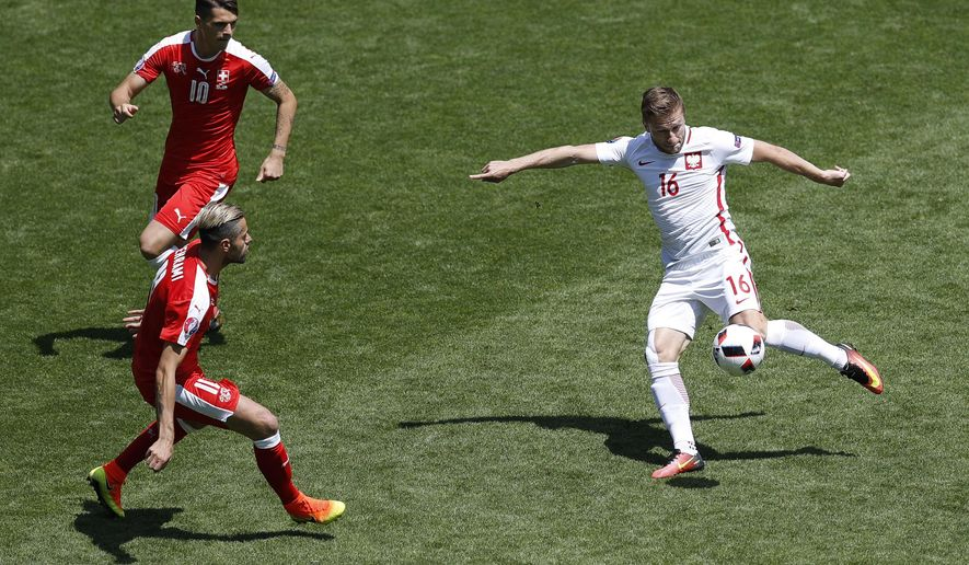 Poland's Jakub Blaszczykowski shoots at the goal during the Euro 2016 round of 16 soccer match between Switzerland and Poland, at the Geoffroy Guichard stadium in Saint-Etienne, France, Saturday, June 25, 2016. (AP Photo/Michael Sohn)