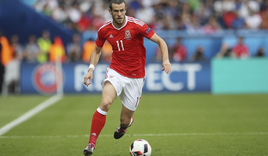 Wales' Gareth Bale dribbles the ball during the Euro 2016 round of 16 soccer match between Wales and Northern Ireland, at the Parc des Princes stadium in Paris, Saturday, June 25, 2016. (AP Photo/Petr David Josek)