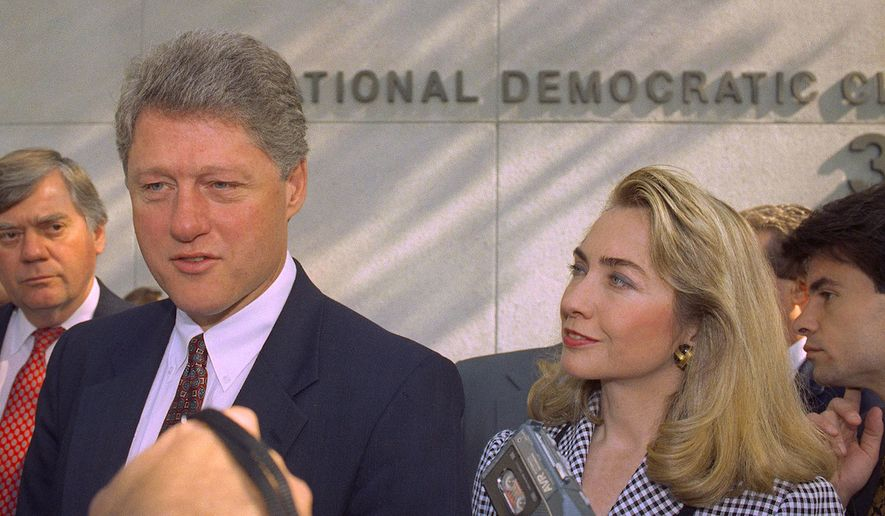 Then-Democratic presidential nominee Bill Clinton and wife Hillary Clinton arrive to campaign in Washington, D.C. on April 29, 1992. (AP/file) ** FILE **