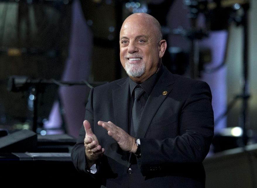 FILE - In this Nov. 19, 2014, file photo, Billy Joel, the recipient of the Library of Congress Gershwin Prize for Popular Song, stands on stage during a concert in his honor at DAR Constitution Hall in Washington. New York Gov. Andrew Cuomo will ride alongside music icon Joel on Monday, June 27, 2016, in a statewide motorcycle ride to raise awareness about breast cancer (AP Photo/Carolyn Kaster, File)