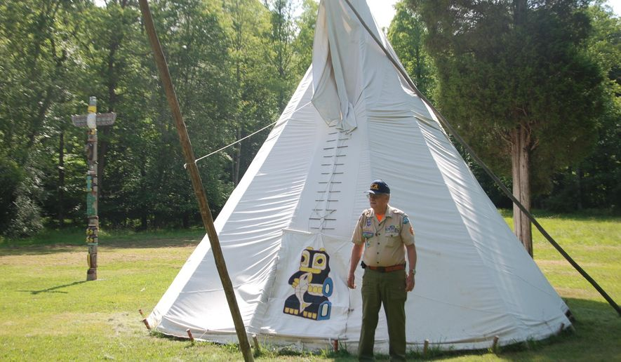 ADVANCE FOR MONDAY JUNE 27 AND THEREAFTER - In this Monday June 13, 2016 photo, Camp ranger John Snyder stands by one of the Native American teepees for the Native American dance shows at Camp Kootaga in Walker W.Va. Snyder, has volunteered at the camp in Wirt County since he was 10 years old. (Brett Kline/The News and Sentinel via AP)