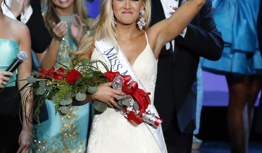 Miss Mississippi 2016 Laura Lee Lewis waves to the audience after being crowned winner during the televised scholarship pageant in Vicksburg, Miss., Saturday, June 25, 2016. (AP Photo/Rogelio V. Solis)