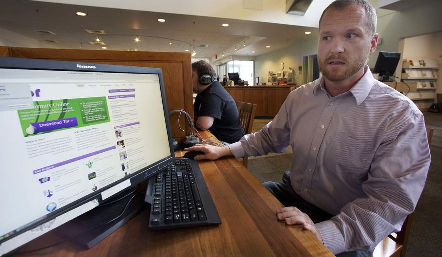 In this photo taken Thursday, May 19, 2016 librarian Chuck McAndrew shows the software, known as Tor network at the Kilton Public Library in Lebanon, N.H. The library was chosen as a test site for the Library Freedom Project that uses secrecy software that largely prevents government surveillance. (AP Photo/Jim Cole)
