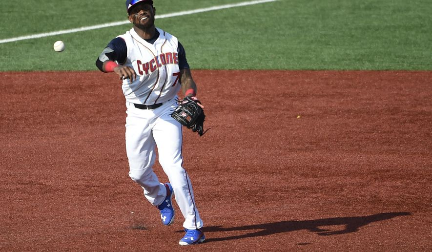 New York Mets' Jose Reyes, playing with the Brooklyn Cyclones, throws to first base to get out Hudson Valley Renegades' Garrett Whitley in the sixth inning of a minor league baseball game, Sunday, June 26, 2016, in New York. Reyes signed a minor league contract with the Mets on Saturday. (AP Photo/Kathy Kmonicek)
