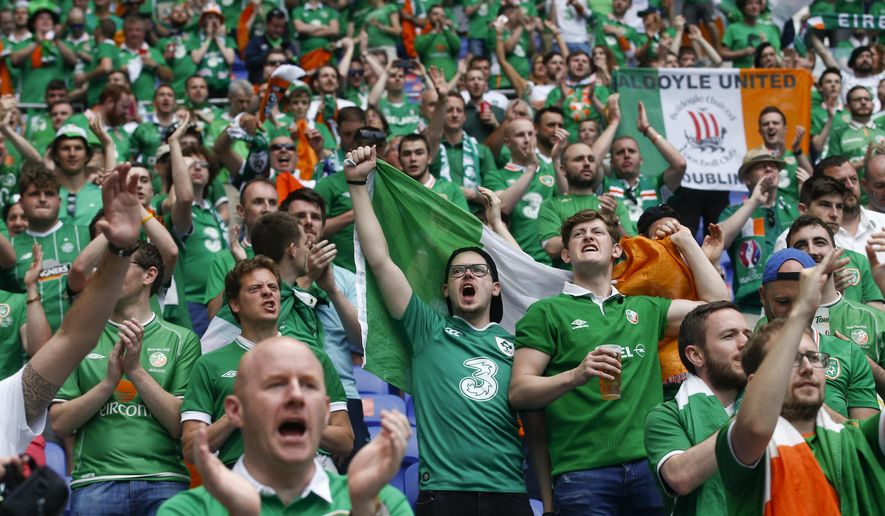 Ireland's supporters cheer during the Euro 2016 round of 16 soccer match between France and Ireland, at the Grand Stade in Decines-?Charpieu, near Lyon, France, Sunday, June 26, 2016. (AP Photo/Thibault Camus)
