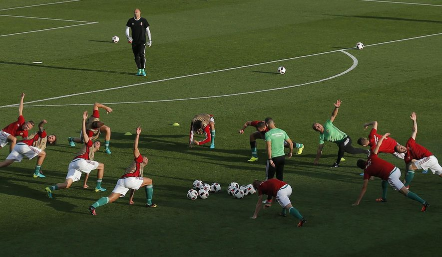 Hungary's players stretch during the last training session prior the Euro 2016 round of 16 soccer match between Hungary and Belgium, at the Stadium municipal in Toulouse, France, Sunday, June 26, 2016. (AP Photo/Francois Mori)