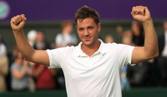 Britain's Marcus Willis, the world number 772, celebrates his victory over 54th-ranked Lithuania's Ricardas Berankis 6-3 6-3 6-4 on day one of the Wimbledon Tennis Championships in London, Monday, June 27, 2016. (Adam Davy/PA via AP) UNITED KINGDOM OUT  NO SALES NO ARCHIVE