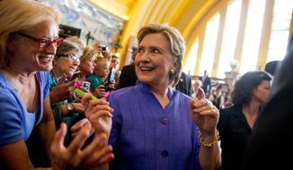 Democratic presidential candidate Hillary Clinton greets members of the audience following a rally at the Cincinnati Museum Center at Union Terminal in Cincinnati, Monday, June 27, 2016. (AP Photo/Andrew Harnik)