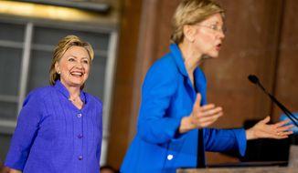 Sen. Elizabeth Warren, D-Mass., accompanied by Democratic presidential candidate Hillary Clinton, left, speaks at the Cincinnati Museum Center at Union Terminal in Cincinnati, Monday, June 27, 2016. (AP Photo/Andrew Harnik)