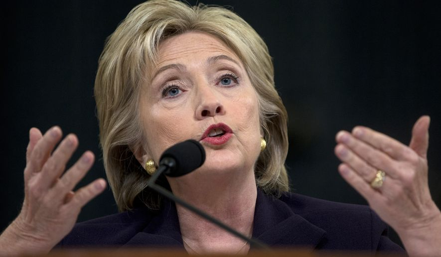 In this Oct. 22, 2015, file photo, Democratic presidential candidate former Secretary of State Hillary Rodham Clinton testifies on Capitol Hill in Washington before the House Select Committee on Benghazi. (AP Photo/Carolyn Kaster, File)