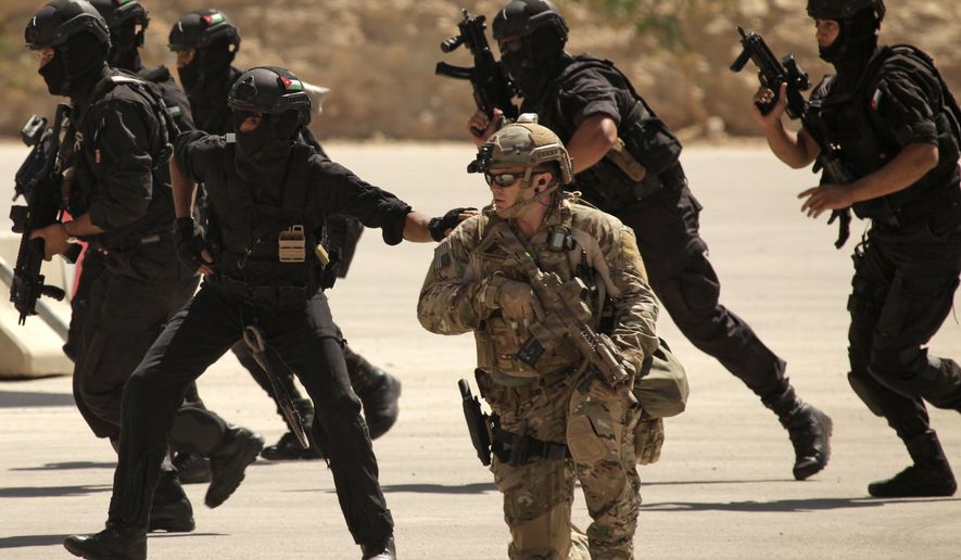Special operations forces from Iraq, Jordan and the U.S. conduct an exercise as part of Eager Lion multinational military maneuvers at the King Abdullah Special Operations Training Center in Amman, Jordan, on June 20, 2013. (Associated Press)