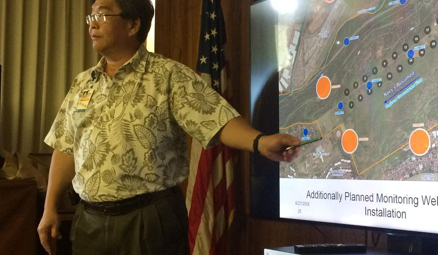 Honolulu Board of Water Supply chief engineer Ernest Lau points at a map during a meeting in Honolulu, Monday, July 27, 2016 to show where the Navy plans to build wells to monitor potential contamination from giant military fuel storage tanks. The U.S. Environmental Protection Agency told Honolulu water utility officials it approved three out of four new wells the Navy plans to build to help monitor the threat of leaks from the tanks near Pearl Harbor. (AP Photo/Audrey McAvoy)
