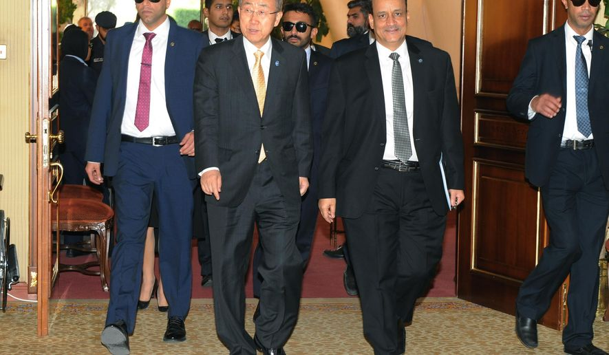 """In this Sunday, June 26, 2016 photo released by the Kuwait Ministry of Information and made available Monday, June 27, U.N. Secretary-General Ban Ki-moon, second left, arrives for the Yemeni Peace Talks with Yemeni delegations in Kuwait. Ban urged Yemen's warring factions to keep working toward a comprehensive agreement, warning that """"time is not on the side of the Yemeni people,"""" in remarks Sunday to delegates taking part in peace talks that began in Kuwait two months ago. (Kuwait Ministry of Information via AP)"""
