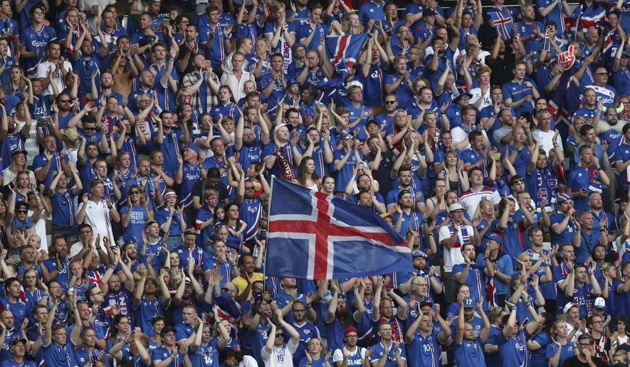 Iceland supporters cheer on the stands before the Euro 2016 round of 16 soccer match between England and Iceland, at the Allianz Riviera stadium in Nice, France, Monday, June 27, 2016. (AP Photo/Claude Paris)