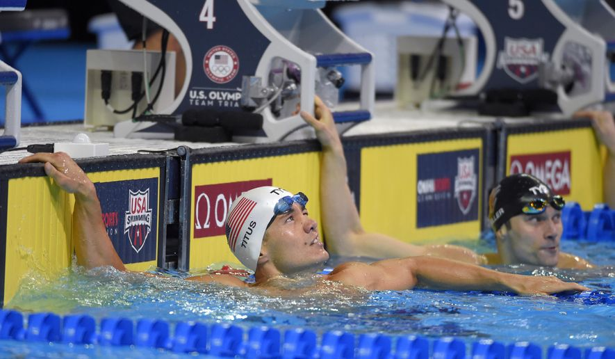 Marcus Titus checks his time after a men's 100-meter breaststroke semifinal at the U.S. Olympic swimming trials, Sunday, June 26, 2016, in Omaha, Neb. (AP Photo/Mark J. Terrill)