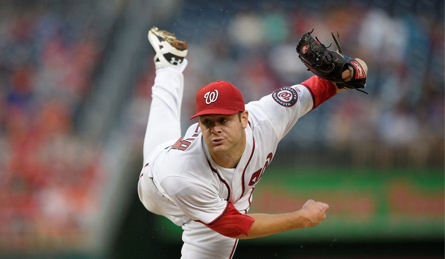 Washington Nationals pitcher Lucas Giolito had to wait through an hour rain delay to make his major league debut on Tuesday, but delivered a first-pitch 95 mph fastball. (Associated Press)