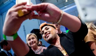 Democratic presidential candidate Hillary Clinton takes a selfie with a member of the audience after speaking at a Digital Content Creators Town Hall at the Neuehouse Hollywood in Los Angeles, Tuesday, June 28, 2016. (AP Photo/Andrew Harnik)
