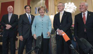 German Chancellor Angela Merkel poses with Senate leaders, Tuesday, June 7, 2011, on Capitol Hill in Washington. From left are, Sen. John McCain, R-Ariz., Sen. Marco Rubio, R-Fla., , Merkel, Senate Majority Leader Harry Reid of Nev., and Sen. Richard Lugar, R-Ind. (AP Photo/Alex Brandon)